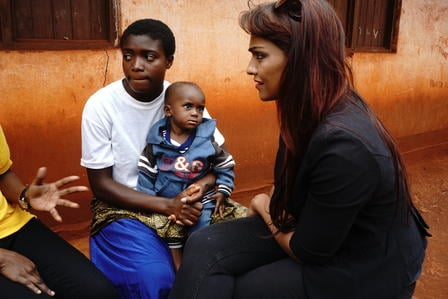 Danielle de Niese with refugees in Tanzania
