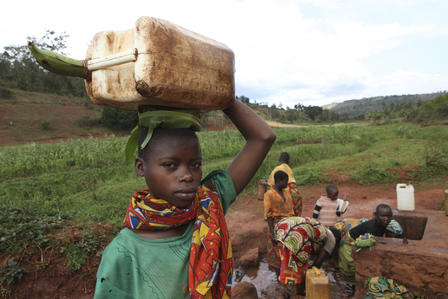 Children fetch water from a well in the Muyenga province of Burundi