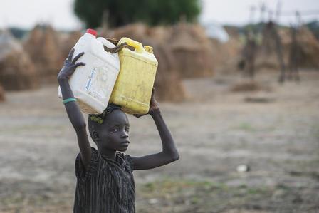 A boy fetches water in a camp in Ganyliel