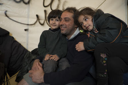 Mohammad Hamadeh with his two children, Mustafa, 4 and Yara, 6, in a tent in a Greek refugee camp.