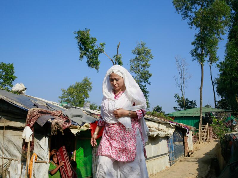 Razia walking through the camps near Cox's Bazar where close to one millions Rohingya people are living.