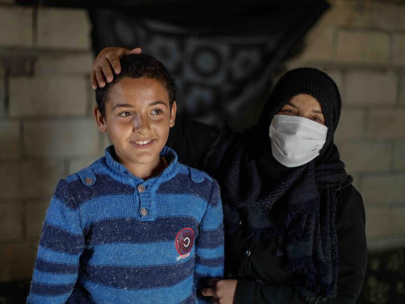 10-year-old Tareq and his mother Muna.