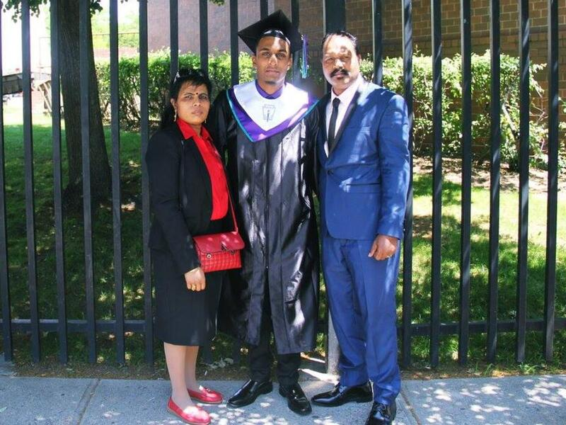 Sarujen and his parents, Shanthini and Sivakumar, at his high school graduation.