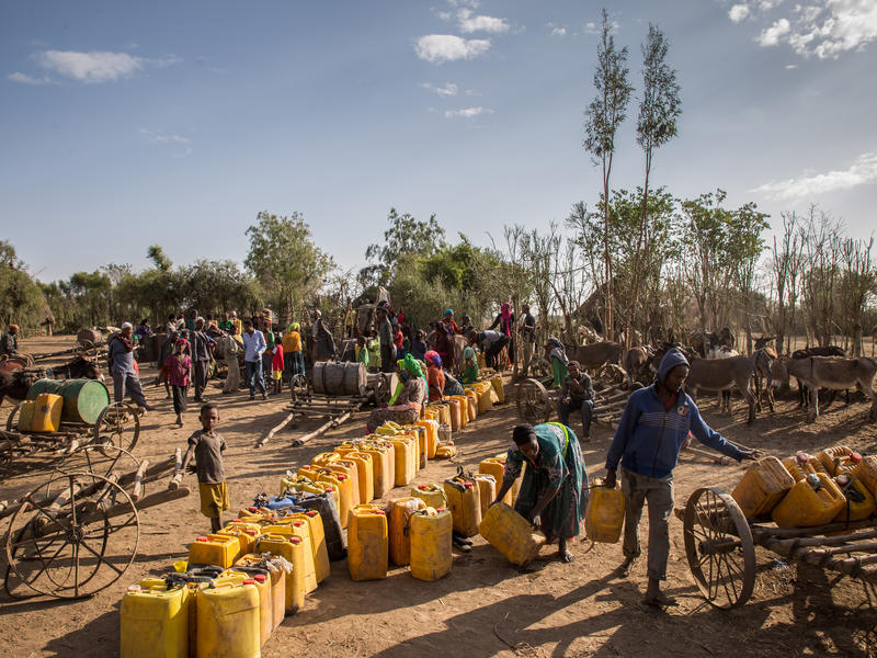 People line up to collect water