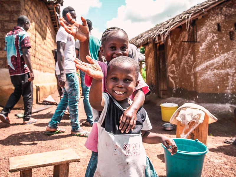 Ivorian children wash their hands