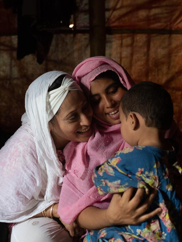 Razia counsels a child and mother in a camp near Cox's Bazar in Bangladesh