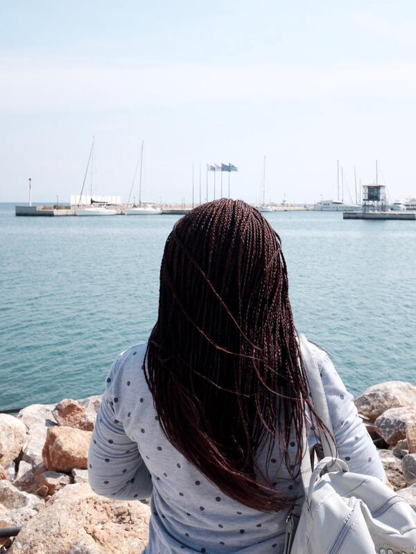 Audrey looks out to sea in Lesvos, Greece, where she fled to from Cameroon.