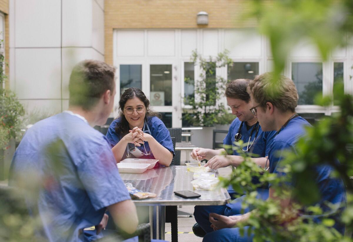 Anxhela has lunch with her colleagues outside of the hospital