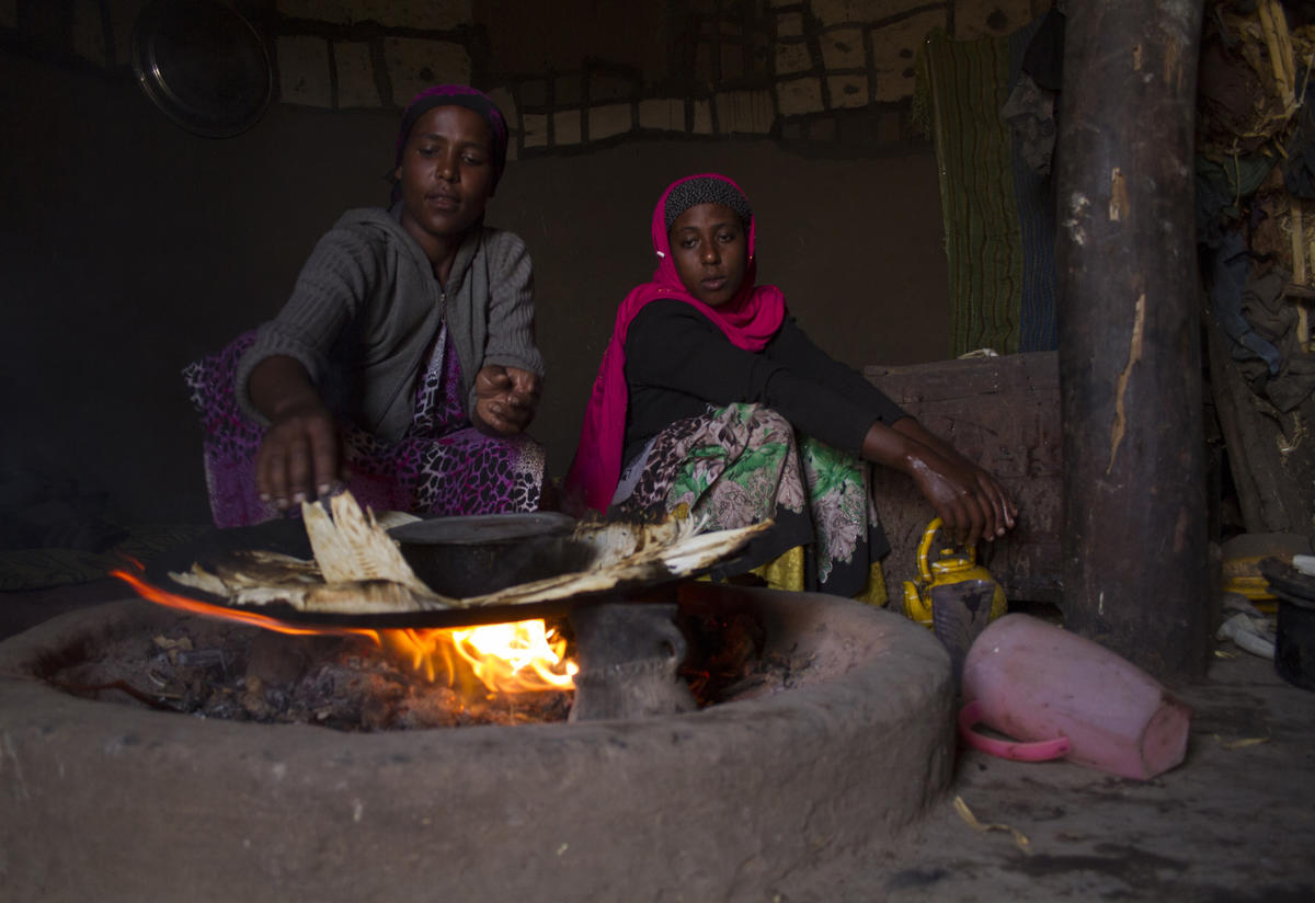 Two Ethiopian women cooking during a drought