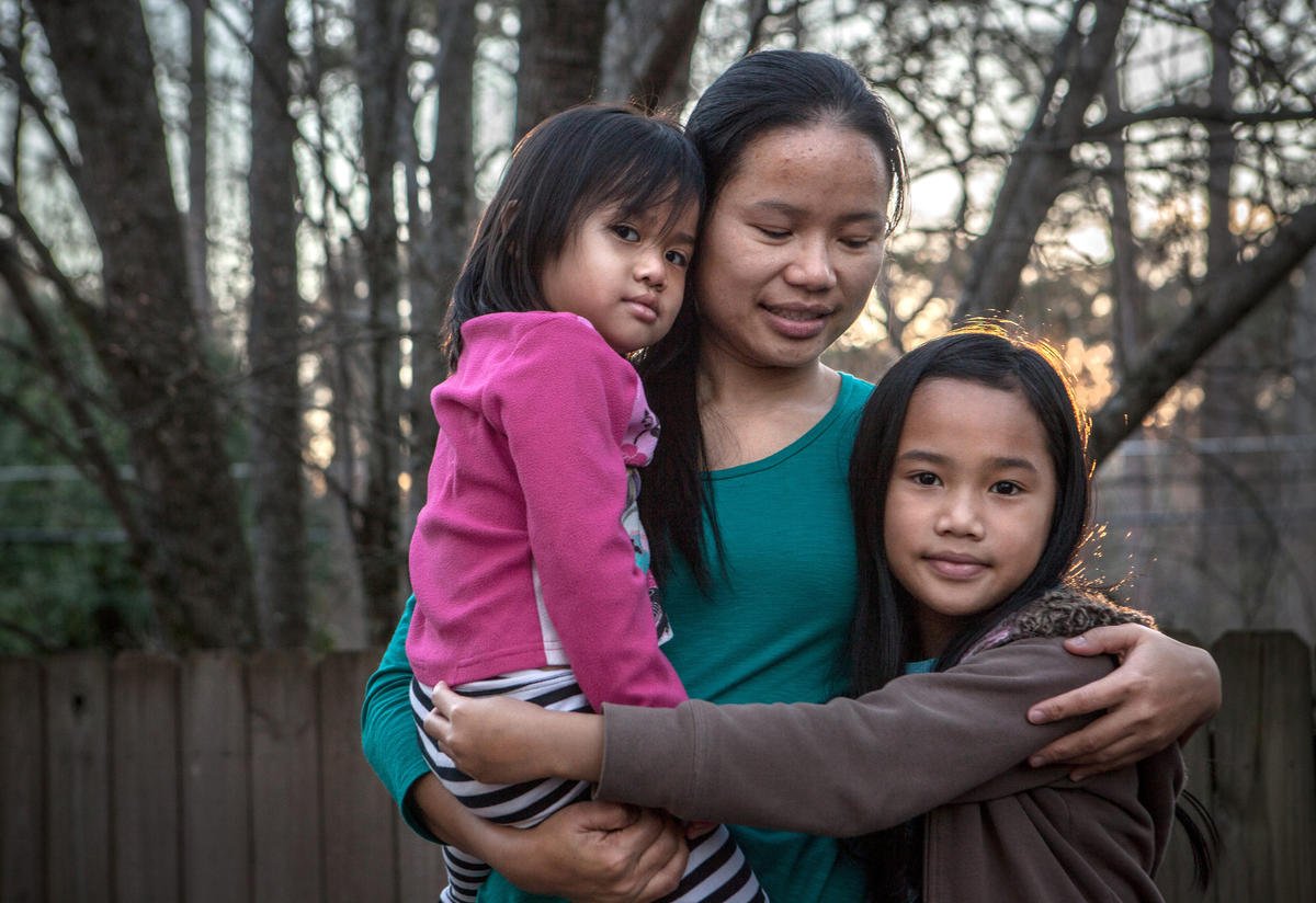 Klaw Htoo with her daughters Gloria and Sophia at their new home in Atlanta