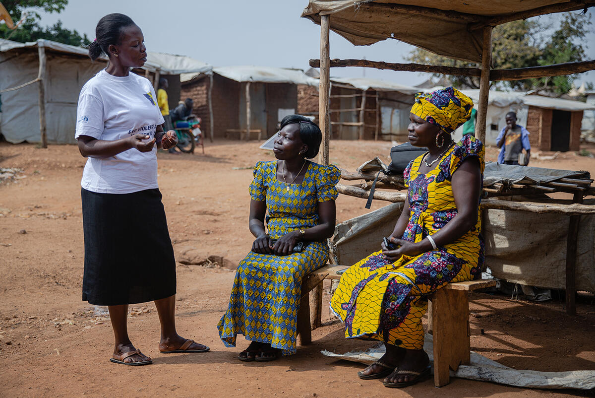 Betty, Grace and Loyce, all members of a refugee women's activist group, enjoy a chat in Bidi Bidi refugee settlement in Uganda