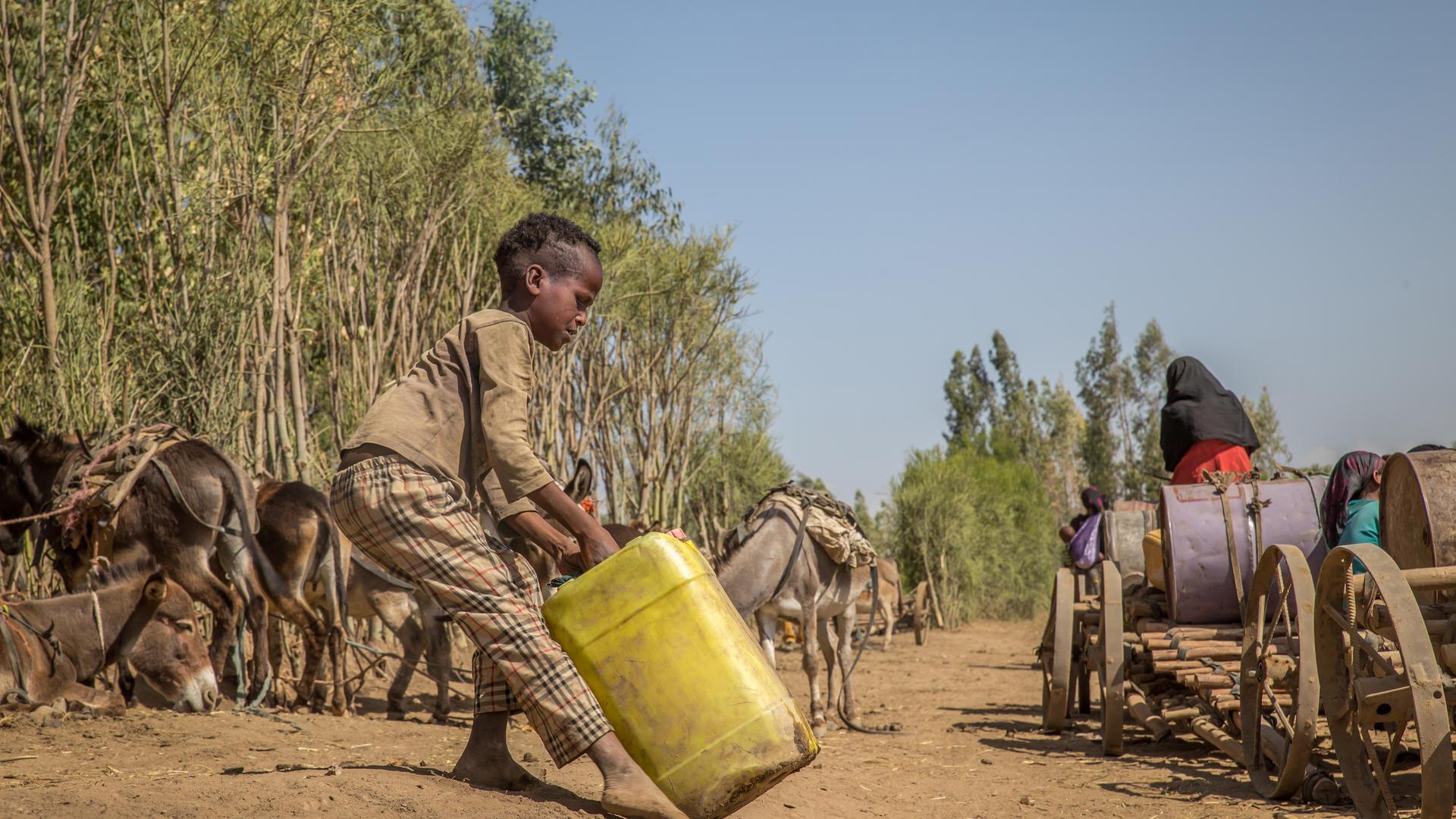 Boy fetching water