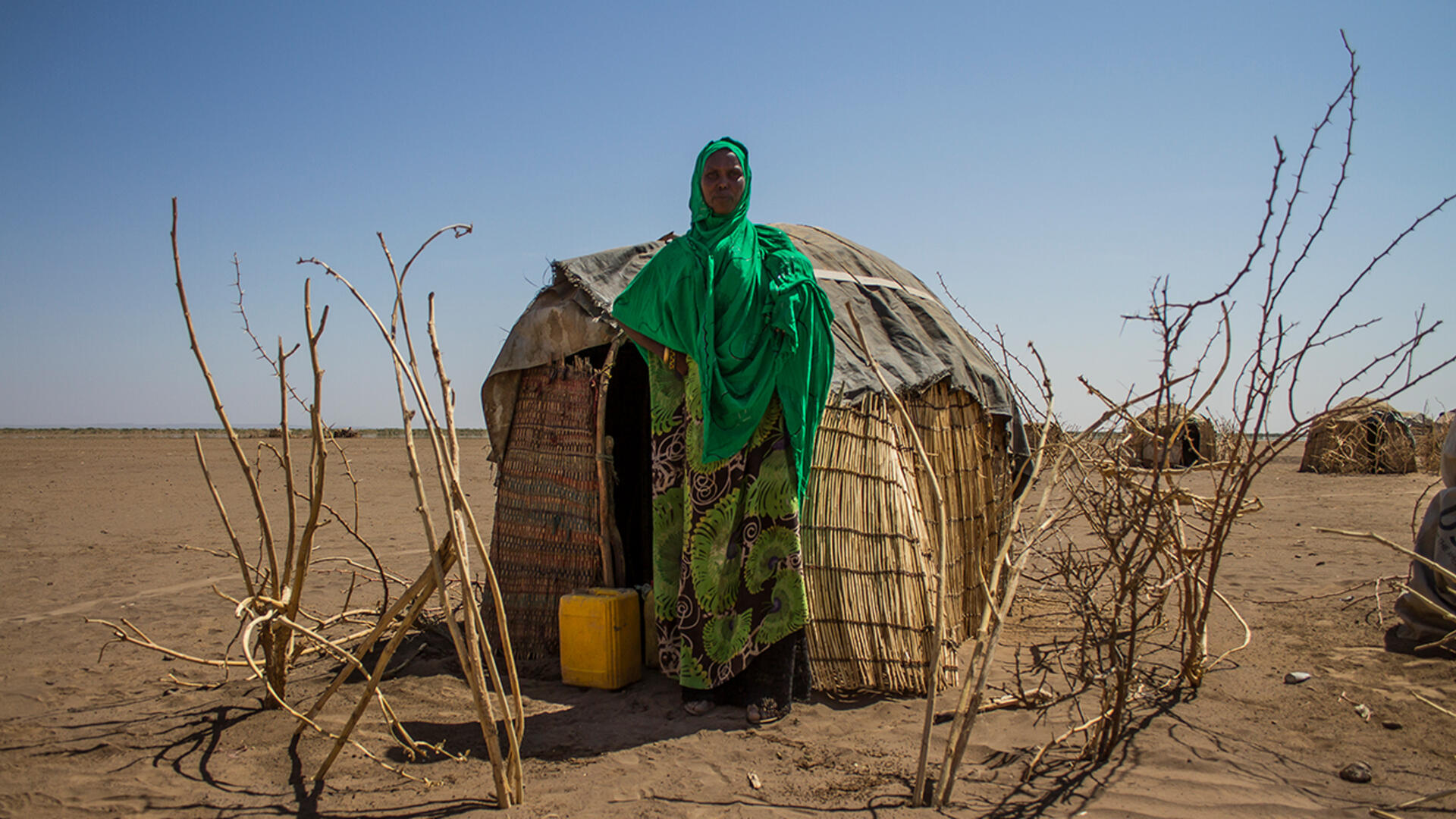 Sada Mohammed, stands in front of her temporary shelter near a remote village in the drought-affected Somali region of Ethiopia.