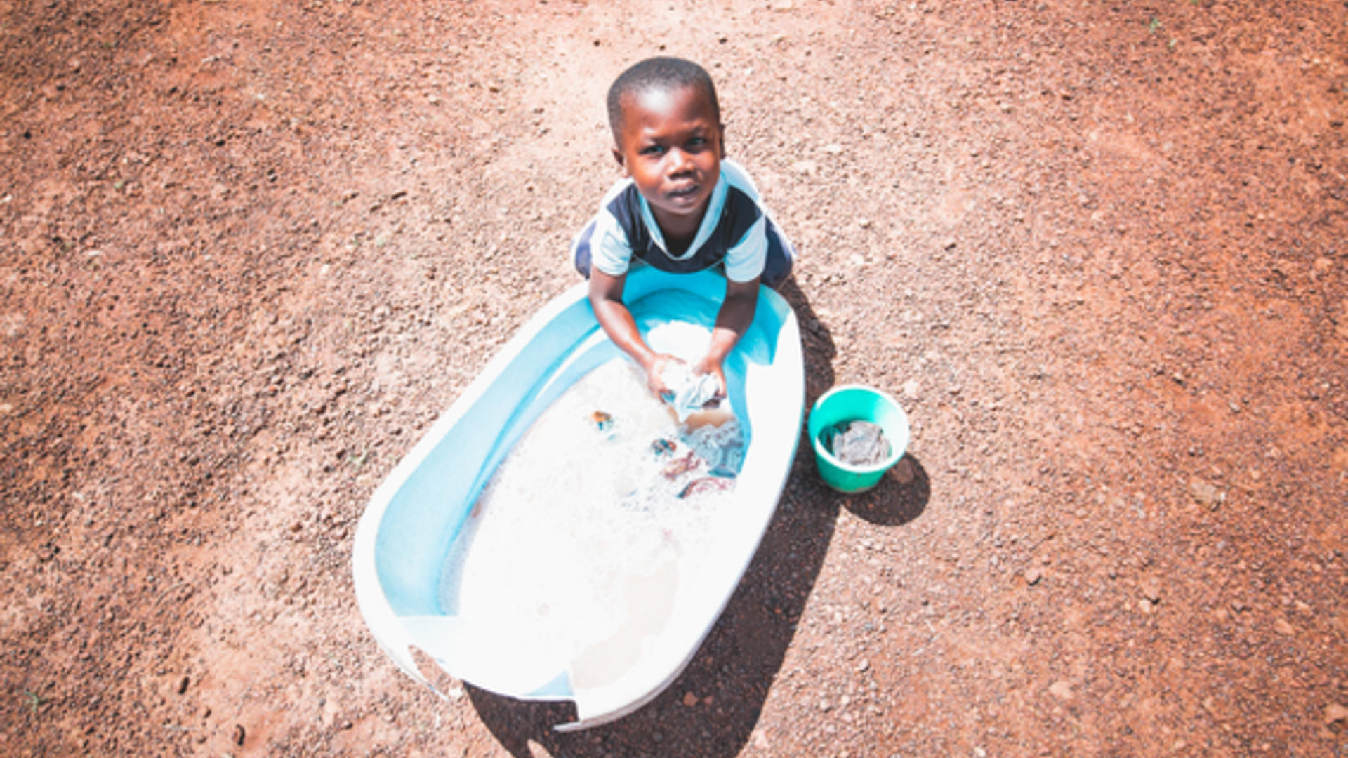 Young boy washes hands